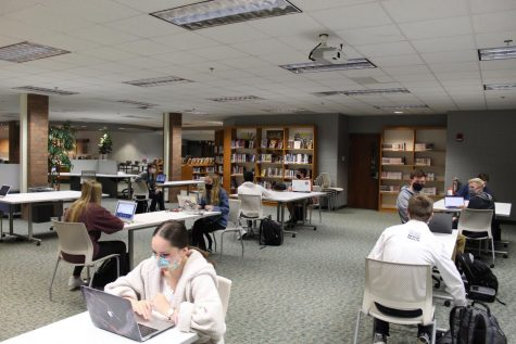 Pictured here are students spreading out as best as possible in the media center for an online-based class as FHC returns to a full-time schedule.