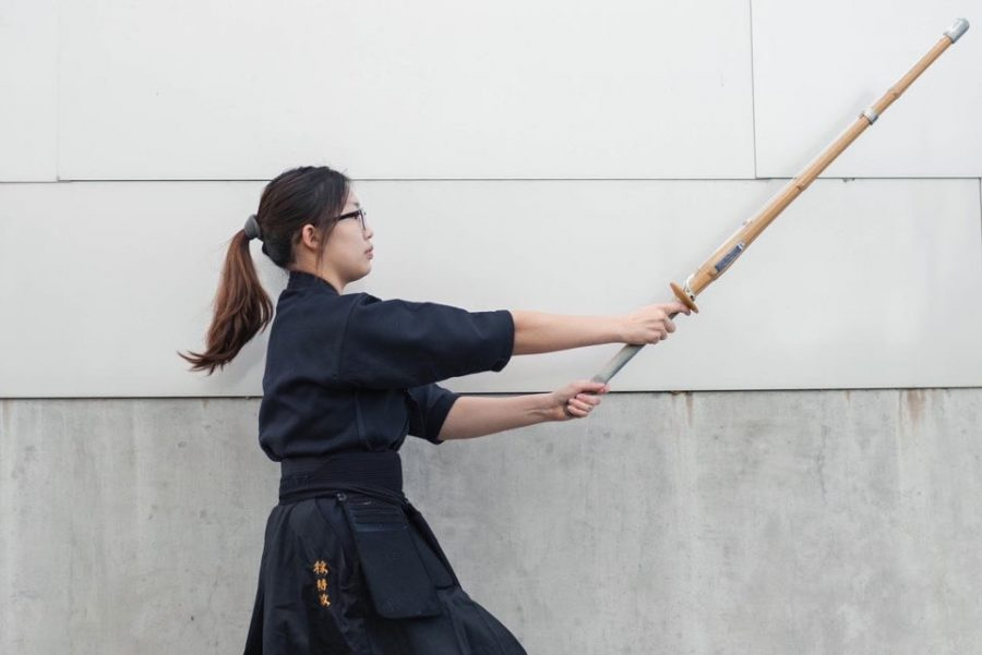 Jimin+Seo+%2722+casts+her+bamboo+sword+forward+as+she+stretches+her+arms+to+perform+her+strike.