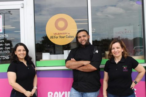Edgar Velazquez stands alongside new co-workers Araceli Prado and Adriana Hernandez outside All For Your Cakes.