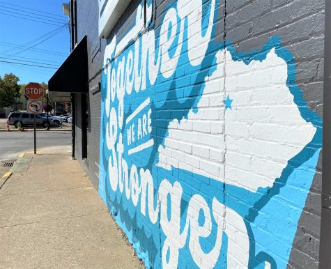 "The ""Together We Are Stronger"" mural outside of A Cup of Commonwealth is more than just a painting. For many Kentuckians, it represents how the state came together during the COVID-19 pandemic."