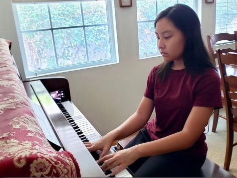 "With her iPhone placed on the far right end of her piano set for video recording, sophomore Lauren Pak starts her practice session Aug. 19 from her Fullerton home, playing a composition titled, ""Promise of the World,"" from the Japanese anime, ""Howl's Moving Castle.""  Pak will eventually record the final version as a trio with two other student volunteers as part of the Harmony4Homes community service project that she started in the summer to send video music performances to the elderly in local and national nursing homes."