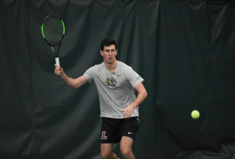 Lafayette College freshman Josh Wolfe prepares to hit the tennis ball during a morning match against St. Francis College on Feb. 9.