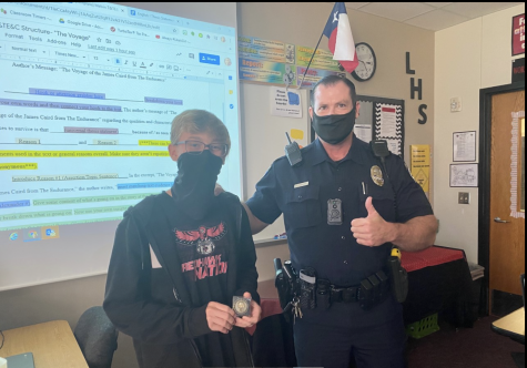 """Responding quickly to a classmate undergoing a medical emergency by calling 911, freshman Carsten Swallow was presented with a Frisco PD challenge coin by School Resource Officer Glen Hubbard in recognition of his actions.  """"I definitely think this will impact me and the way I think,"""