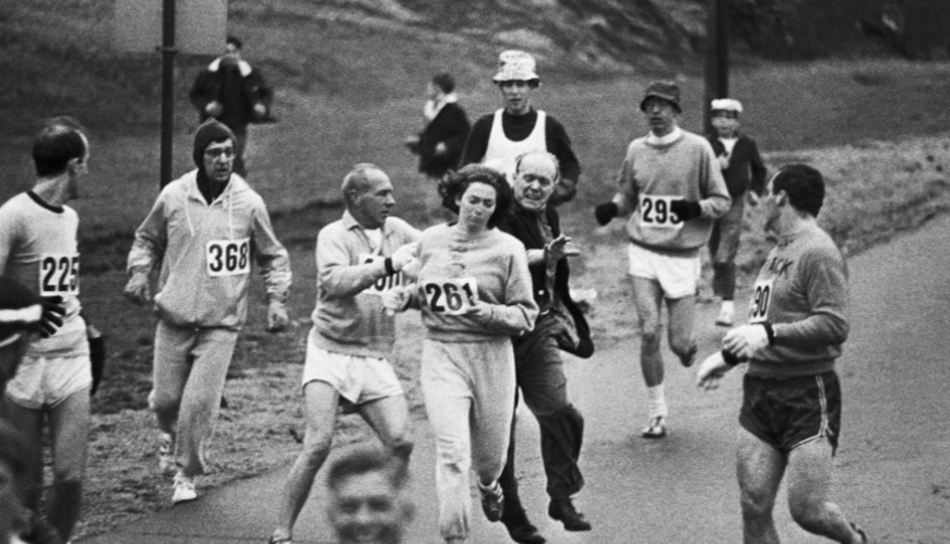 Race+officials+attempting+to+stop+Kathrine+Switzer+from+running+the+Boston+Marathon.+Switzer+became+the+first+registered+woman+to+ever+officially+run+the+marathon%2C+encouraging+a+change+in+athletics+legislation+calling+for+more+gender+equality+in+marathons.+