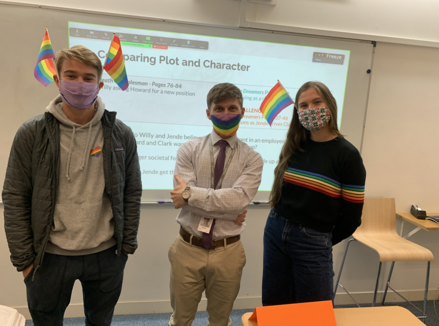 Owen+Humphries+%28%E2%80%9922%29%2C+English+Teacher+Sean+Linton+and+Cece+Muecke+%28%E2%80%9921%29+join+the+Gender-Sexuality+Alliance%E2%80%99s+silent+protest%2C+wearing+rainbow+colors+to+show+support+for+the+LGBTQIA%2B+community.+After+middle+school+students+hung+up+a+Trump-Pence+campaign+flag+Oct.+19%2C+GSA+encouraged+students+to+show+up+to+school+Oct.+26+wearing+rainbows+on+masks%2C+flags+and+stickers.