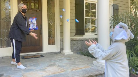 "Noble Park resident tosses candy to a trick-or-treater, a method called ""Yeet the Treat,"" to try and stop the spread of COVID-19."