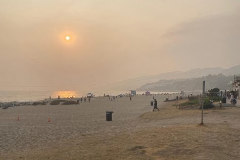 AIR: Smoke from fires as that ravaged the West Coast filled the skies Sept. 13, shrouding the sun at Will Rogers State Beach in the Pacific Palisades. The nearest fire was the Bobcat Fire in Pasadena.