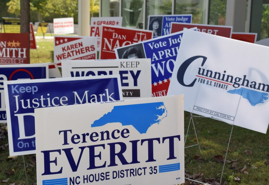 Clusters+of+campaign+signs+for+local+elections+sit+on+the+side+of+an+Early+Voting+building.+