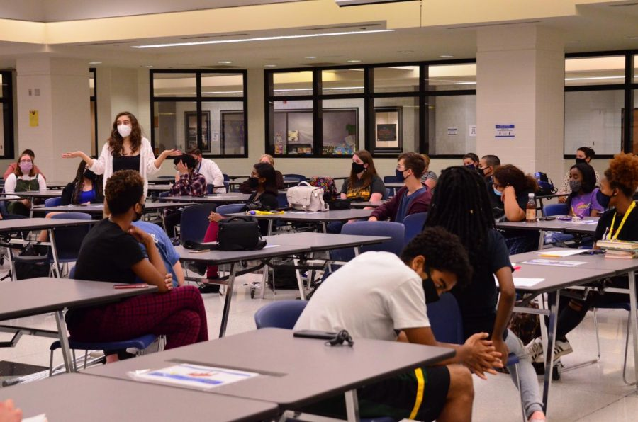 "Senior Isabella Fallahi speaks to students and staff at the racial equity meeting hosted by the Black Student Alliance on Sept. 24. ""I think the meeting as a whole was productive because not only were we able to voice our opinions and what the facts were and how we felt about that situation, but it was also a time where the people in charge had to sit down and listen,"