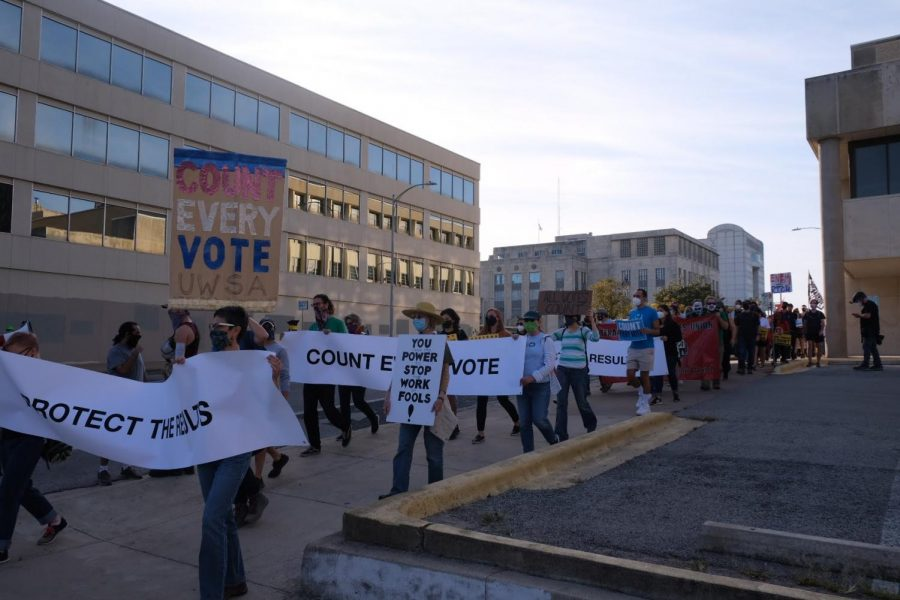 As part of a demonstration that began at Woolridge Square and continued to the Texas Capitol, a hundred protestors gathered to insist that every ballot be counted in the 2020 election after the president argued that elections officials should stop counting ballots after Election Day.