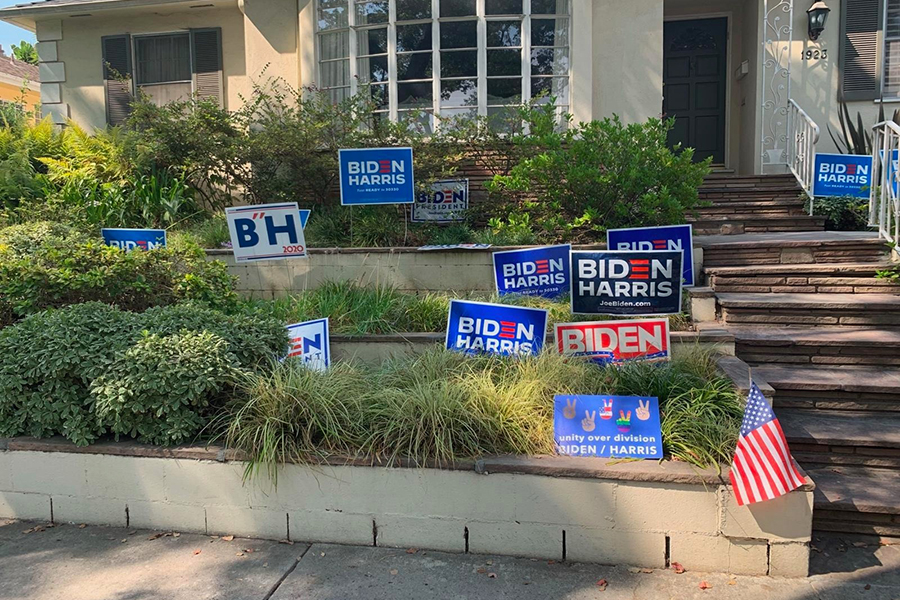 RECOVERED: Stolen political yard signs were set up on the front lawn of Amanda Kogan in Beverlywood Oct. 5 so people could pick them up. Ms. Kogan posted on NextDoor that she'd found the signs, which had been dropped in a pile on Wooster and 18th streets.