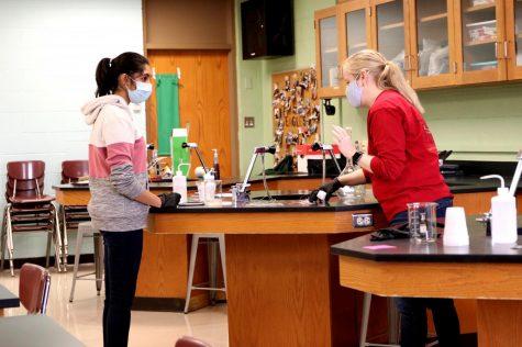 AP Biology teacher Andrea Adams works with senior Deepika Sitaraman on a lab in November of 2020.