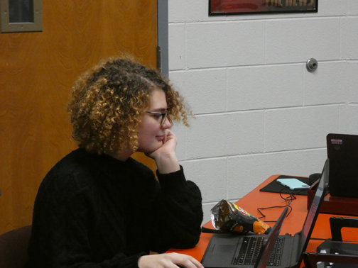 "SOMEBODY IS WATCHING. Scribe opinion editor Anna Harrington works on a school-issued laptop. Teachers can use software called ""Netop"" to observe students"