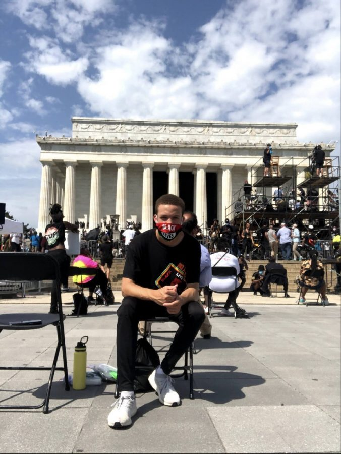 Ashton Brown attending the Black Lives Matter March on Washington in front of the Lincoln Memorial.
