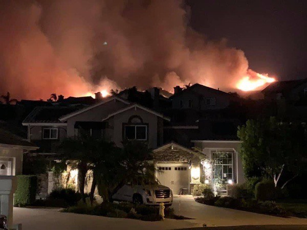 Math teacher Jennifer Collier's parent's house at the edge of the Silverado Fire in Irvine. Tens of thousands of Irvine, Brea, and Chino Hills residents were evacuated due to the fast-moving dual fires -- Blue Ridge and Silverado.