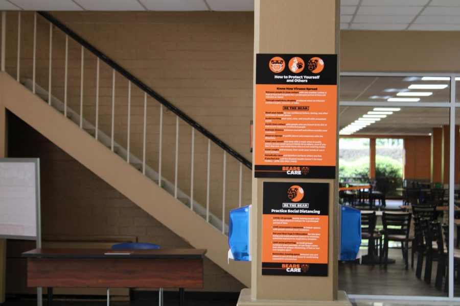 Signage in the Connell Student Center informs patrons about university safety measures during the COVID-19 pandemic.