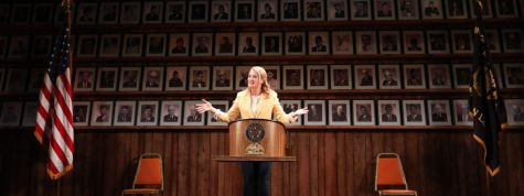 "Photo by Joan Marcus. Heidi Schreck speaks to the audience during a 2019 performance of ""You Be My Ally"" at The Hayes Theater on Broadway."