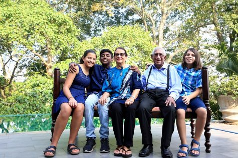 Here Senaratna smiles for a photo with her grandparents, brother and cousin in Sri Lanka.
