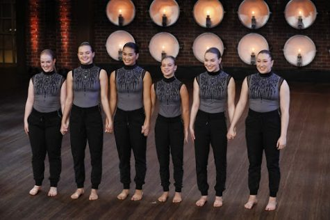 "Competitive dance team, ""The Difference"", stands in anticipation as the judges give feedback for their piece in the callback round on ""World of Dance""."