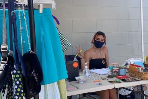 At her booth at the Silverlake Flea Market,  Giuliana Casciani '21 sells numerous items other than vintage clothing, including crystals, books, and even fairy wings.