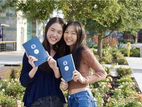 "Lu and Zhou pose with their paperback versions of ""Tempo."" A collection of these photos were posted on both Lu and Zhou"