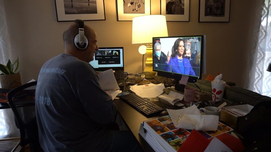 As he shares his video feed over Zoom to his round table advisement class, teacher Dave Winter watches Kamala Harris take the oath of office to become the first woman vice president in United States history.