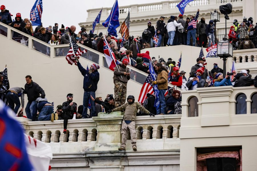Pro-Trump supporters storm the U.S. Capitol following a rally with President Donald Trump on Wednesday, Jan. 6, 2021 in Washington, D.C. Congress held a joint session Wednesday to ratify President-elect Joe Biden's 306-232 Electoral College win over President Trump. A group of Republican senators said they would reject the Electoral College votes of several states unless Congress appointed a commission to audit the election results.
