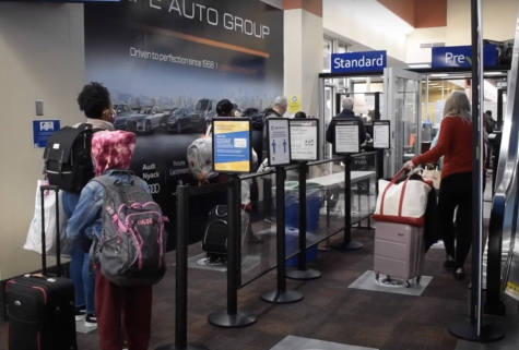 Travelers went on line at a security checkpoint at Westchester County Airport in White Plains New York. Experts fear that increased travel during the holidays will lead to a pandemic surge in the new year.