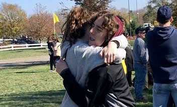 Hugging.  Juniors Mackenzie and Aidan Kelley hug each other. They are twins and run cross country together.