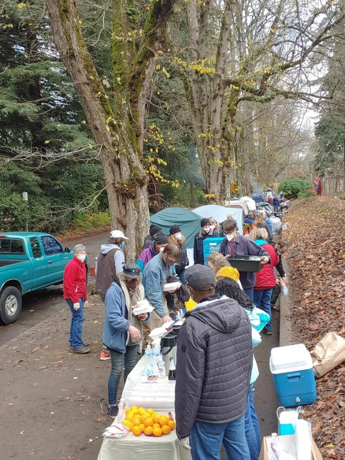Houseless+Portlanders+line+up+to+receive+food+outside+Laurelhurst+Park+in+SE+Portland.+Many+have+criticized+the+city+of+Portland+for+removing+camps+without+a+better+option+available+to+those+who+are+being+displaced.
