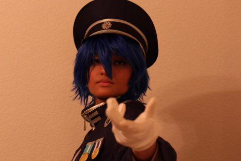 Coppell High School senior Sneha Kumar dresses as Kaito from Vocaloid, a singing voice synthesizer software product at her home on Wednesday. Kumar has been cosplaying and voice acting since seventh grade. Photo by Olivia Cooper.