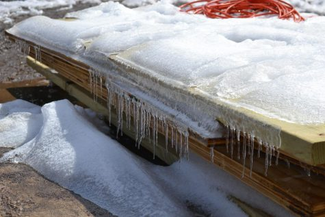 Icicles and snow cover the corners of the building site of the outdoor stage. The winter storm caused the first weekend run of Urinetown, the school musical, to be canceled. Urinetown will resume rehearsals this week and will now debut March 4.