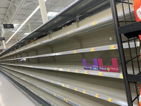 Senior Ronald Waiter takes a picture of an empty grocery store aisle. HEB, a Texas grocery store, was cleared out before and during the snow storm event in Texas. However, they have been praised for their preparedness before, during, and after the storm.