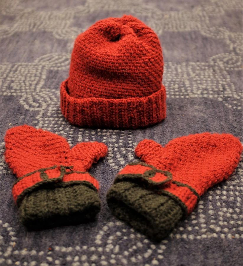 A successful hat and mitten set; it contains both deliberate and accidental imperfections .