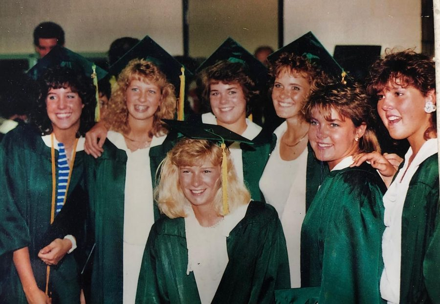 Mrs.+Zietz%E2%80%99s+high+school+graduation+in+Bloomington%2C+Illinois.+Her+friend+Leslie+is+second-left%2C+Mrs.+Zietz+is+in+the+middle%2C+and+Buffy+is+third-right.+The+friends+since+%E2%80%9Chave+a+monthly+Zoom+call%2C+plus+three+more+not+pictured%2C%E2%80%9D+Mrs.+Zietz+said.+%E2%80%9CEvery+one+of+these+girls+were+in+the+cornfields+that+night%21%E2%80%9D+