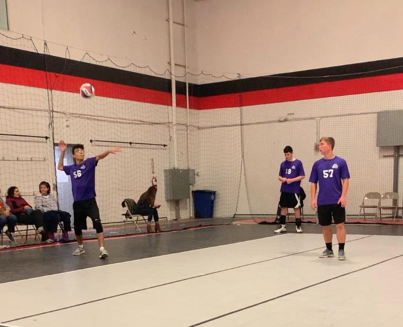 Junior+Ayham+Elayan+serves+the+ball+at+NVVA+with+his+2019+fall+CYA+team.