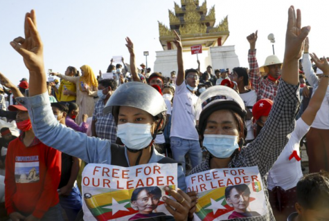 On Monday, Feb. 2, Burmese civilians hold up signs in protest after the military detains the State Counsellor, Aung San Suu Kyi.