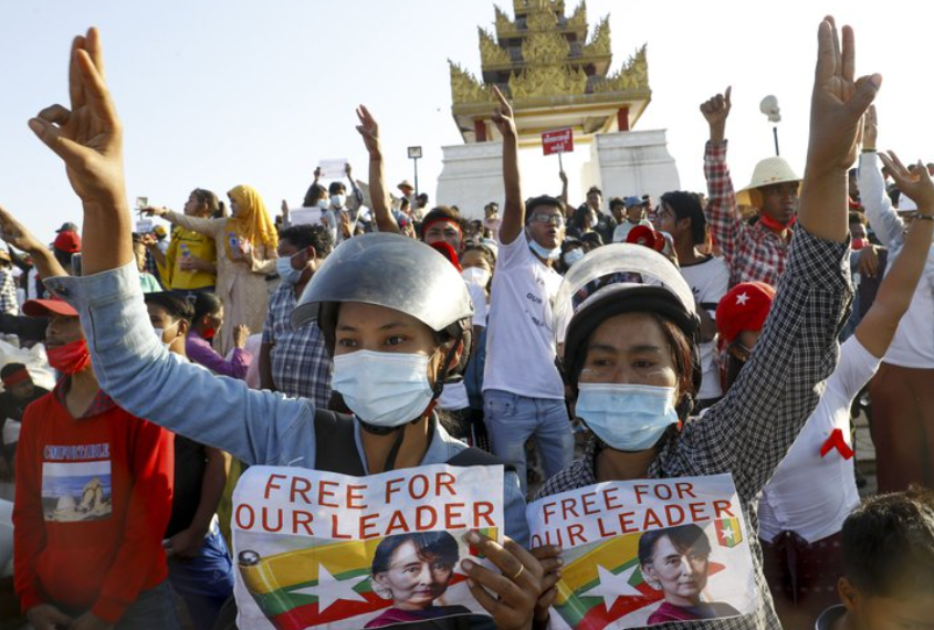 On+Monday%2C+Feb.+2%2C+Burmese+civilians+hold+up+signs+in+protest+after+the+military+detains+the+State+Counsellor%2C+Aung+San+Suu+Kyi.+