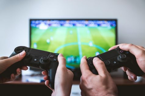 Two players cooperate in a football video game as an experimental form of therapy.