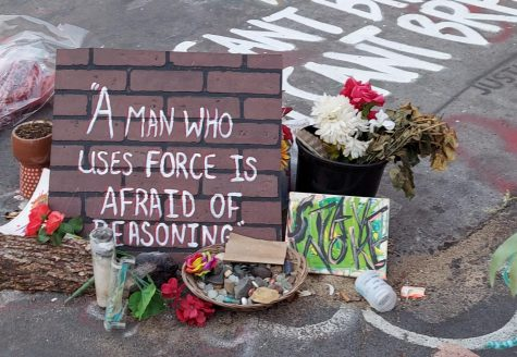 """Placed right by the location Floyd was killed, this note denotes the Kenyan proverb """"A man who uses force is afraid of reasoning."""""""