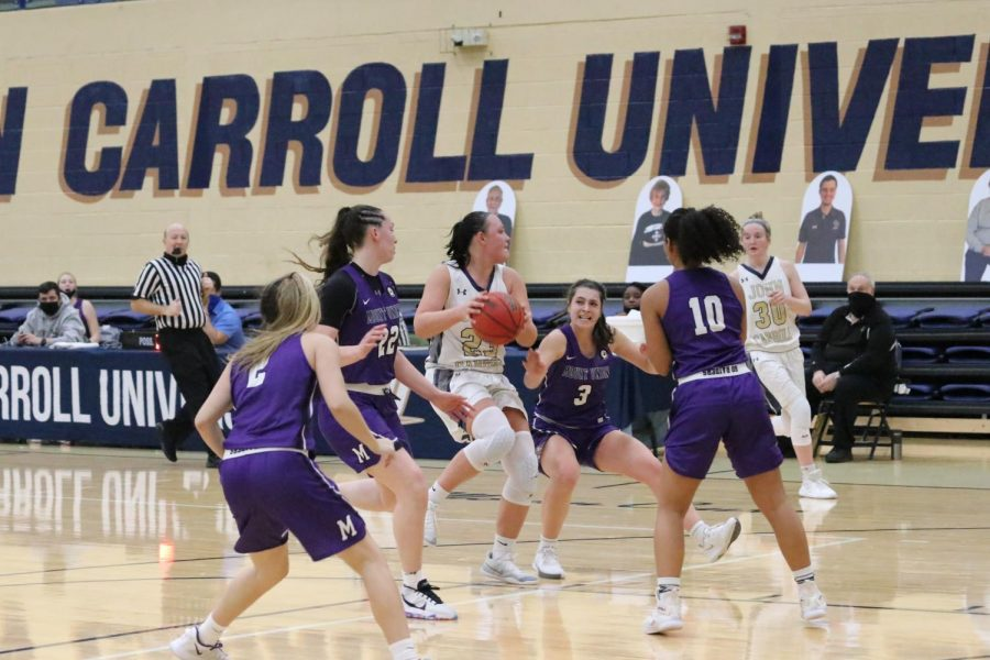 Nicole+Heffington+ball-in-hand%29+is+surrounded+by+four+Mount+Union+defenders+in+a+game+at+the+Tony+DeCarlo+Varsity+Center+on+Jan.+29%2C+2021.