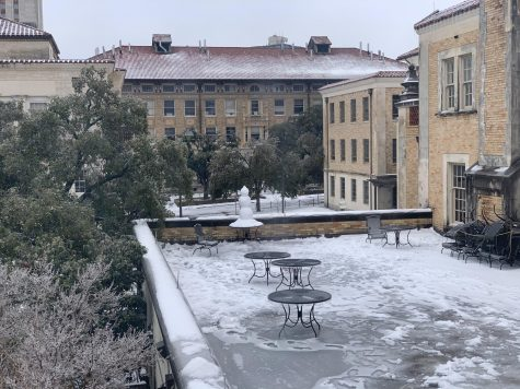 Snow covers the quad next to the cafeteria at the University of Texas at Austin. The university closed campus on Feb. 14 and reopened on Feb. 24 due to the water outage and hazardous weather conditions.