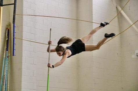 Coppell junior Kinley Wojick pole vaults at the CHS Field House on Wednesday. Wojick has been pole vaulting since seventh grade at Coppell Middle School East and competed in the 2018 and 2019 Junior Olympics.