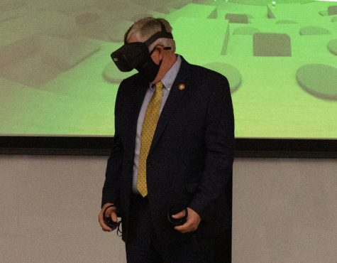 """Governor Mike Parson visited the Lee Summit Missouri Innovation Campus on March 2. Jeff Danley from VMLY&R led Parson through a presentation of the virtual reality demonstration. """"I enjoy bringing in people into virtual reality to help introduce them to new experiences and show what the possibilities are for virtual reality,"""" Danley said. """"With the governor, hopefully it helped him understand how we can use virtual reality in a classroom environment and how that's going to better prepare students here at UCM for the future workforce."""""""