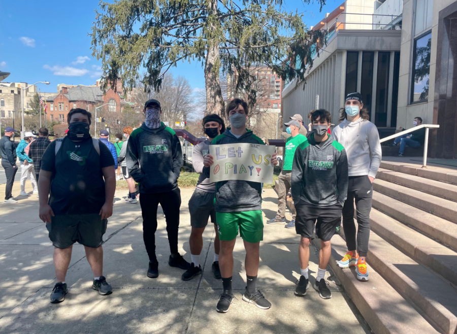 "Walter Johnson high school football players pose for a photo at the March 14 ""Let Us Play"" rally. About 100 MCPS student athletes, parents and coaches gathered to protest restrictions on sports, despite coronavirus outbreaks on Whitman teams."