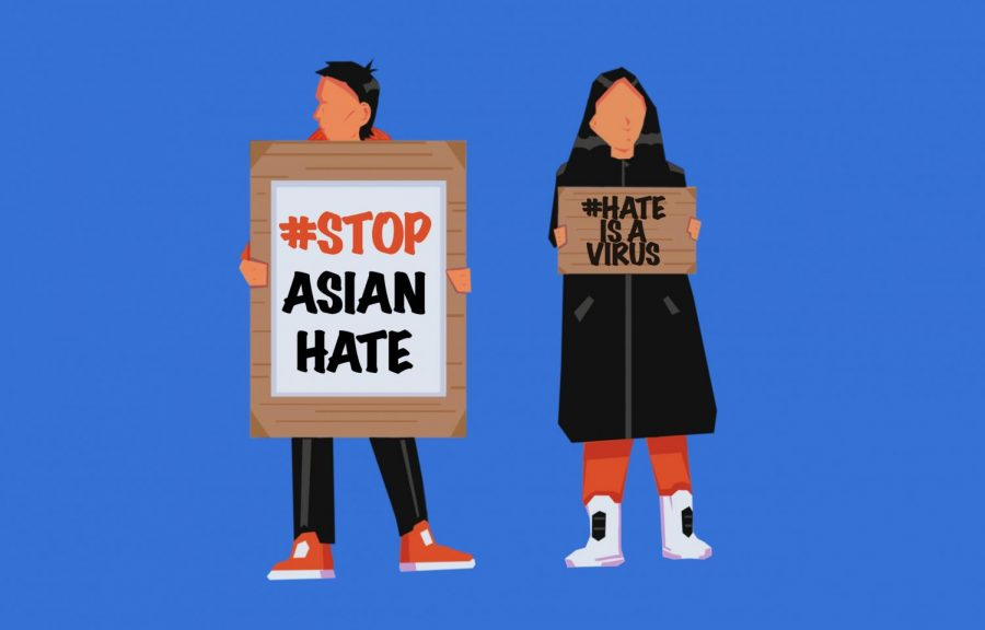 Two+protesters+drawn+with+signs+reading+%2523stopasianhate+and+%2523hateisavirus%2C+trending+social+media+hashtags+on+the+topic+of+violence+towards+Asian+Americans