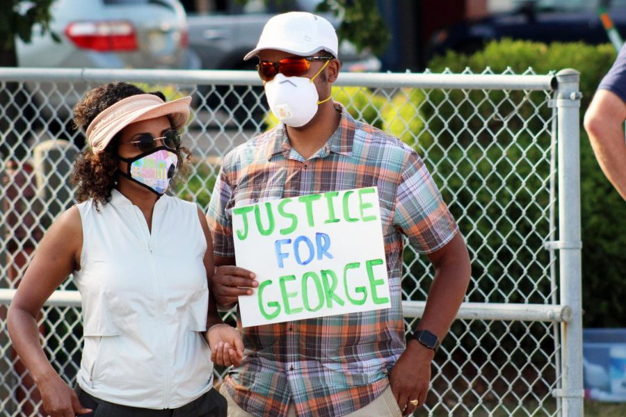 Protesters+hold+up+a+%22justice+for+George%22+sign+at+a+protest+June+4.+Former+police+officer+Derek+Chauvin+is+being+charged+for+the+murder+of+St.+Louis+Park+resident+George+Floyd.