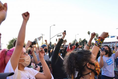 BLM speakers asked their rally participants to raise their fists as they called for the defunding of police during a rally on Feb. 24, 2021. Photo credit: Vincent Medina