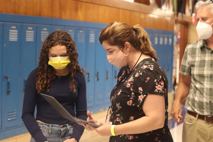 Ms. Crane and Mr. Pass assist a student establish a WiFi connection prior to starting the ninth-grade English STAAR test on Tuesday morning.