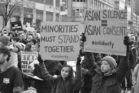 Asian Americans at a 2014 protest in New York. Anti-Asian violence has surged in the past year, but many Asian and Pacific Islander Americans have felt the effects of anti-Asian rhetoric throughout their lives.